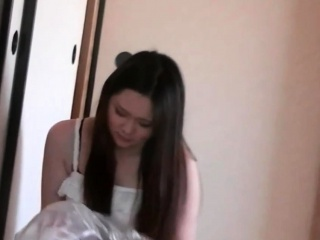 Asian dildo bangs her vag