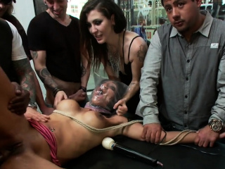 Busty tied slave is fucked in public