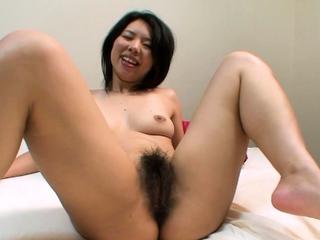Big Hairy Bush On This Horny Japanese MILF