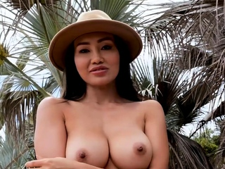 Big tits Asian MILF model strips outdoor