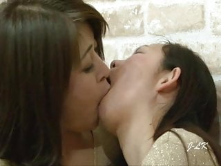 Three Mature Japanese Lesbians Kiss With Such Passion