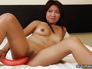 Cute Asian floozy dildo fucks her wet pussy